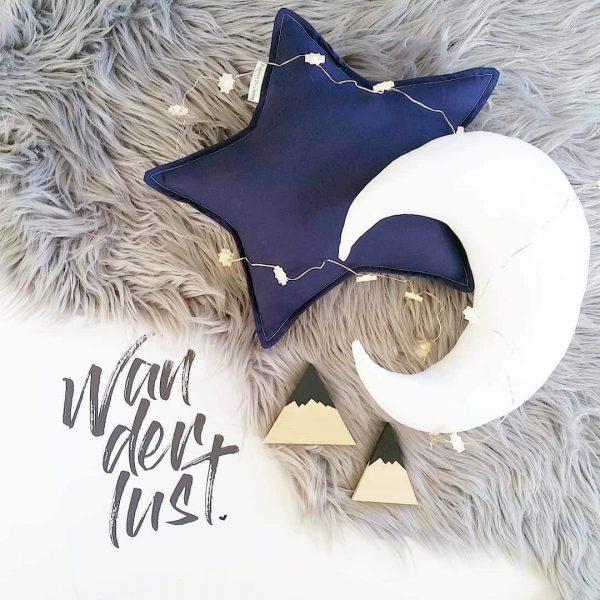 Medium Navy Star Cushion, Medium White Moon Cushion on grey faux fur rug
