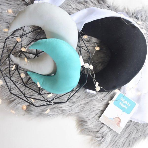 Standard Black, Medium Light Grey, Small Mint Moon Cushions on faux fur grey rug