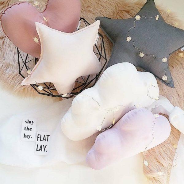 Medium Dusty Pink Heart Cushion, Medium Baby Pink Star Cushion, Standard Dark Grey Star Cushion, Standard White Cloud Cushion, Medium Lilac Cloud Cushion on blush faux fur rug