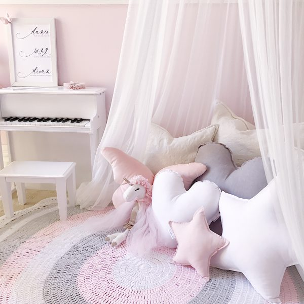 Girls Rooms in pink, white and grey - White Canopy , unicorn soft toy, crochet rug, kids piano and cushions including Standard White Star Cushion, Medium White Heart Cushion, Small Baby Pink Star Cushion