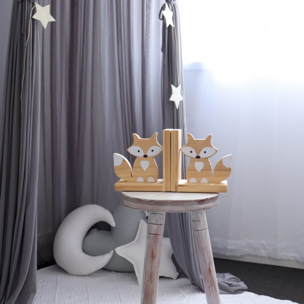 Gender Neutral Nursery - Grey Canopy with Medium White Moon Cushion, Medium Light Grey Heart Cushion, white rug and stool with fox bookends on top