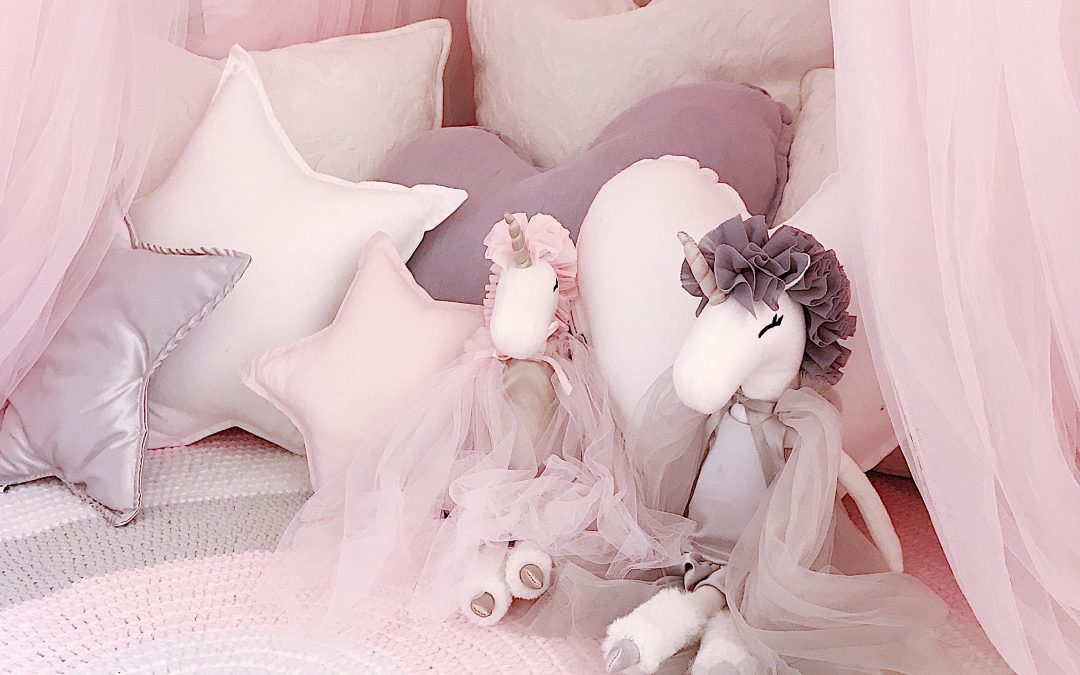 Girls Room in pink, white and grey - Cushion Nook with crochet rug, canopy, unicorn soft toys and star and heart cushions