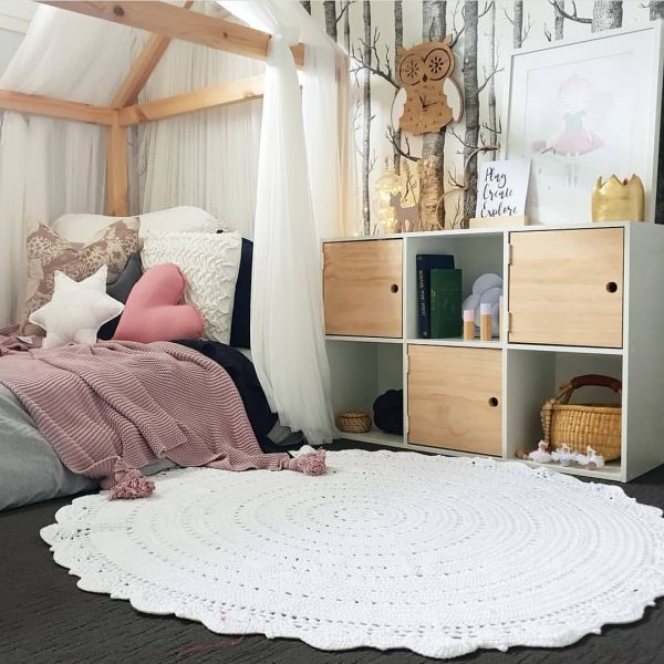 Girls Room - Timber House Bed with Canopy, cube shelves, tree wallpaper, white crochet rug, blush pink blanket on bed and white snowflake, medium dusty pink heart and medium dark grey star pillow cushions