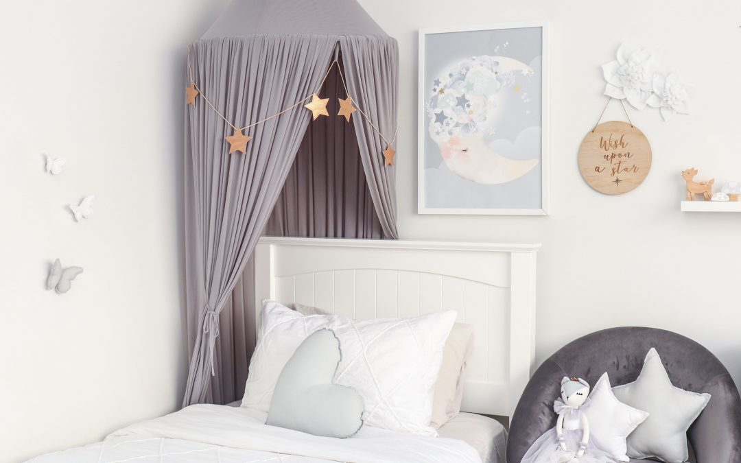 Girls Room in Shade of Grey. Canopy, bed, artwork and chair including medium light grey heart and star cushions