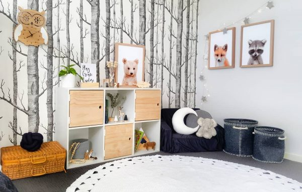 Boys Woodland Bedroom - Forest Themed Wallpaper, Navy, Grey and White features, wooden owl clock, woodland animal artworks, crochet rug, kids armchair and medium white moon cushion