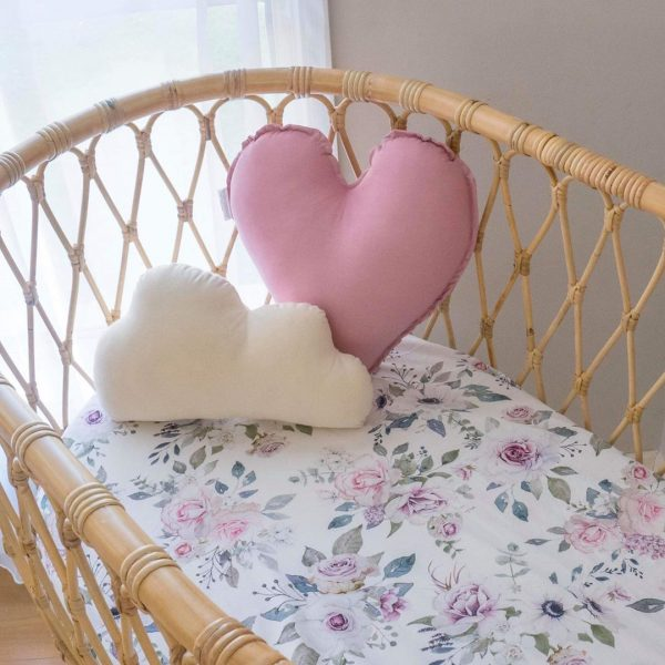 Rattan Bassinet with floral sheets and Medium Dusty Pink Heart Pillow and Small Natural Cloud Pillow