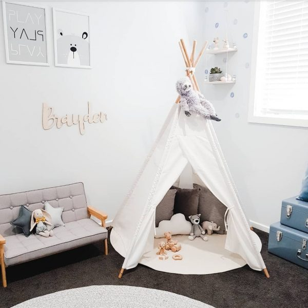 Grey and White Boys Bedroom - Teepee with cushions including small white cloud cushion and some toys, a kids sized sofa with a soft toy bunny and small light and dark grey star cushions sitting on there and some duck egg blue storage cases. Plus some nursery prints and a shelf on the wall