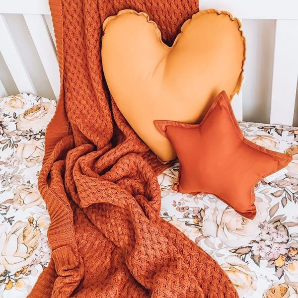 Cot Setup with Rust Throw Blanket, Floral cot sheet, Medium Mustard Heart Pillow and Small Rust Star Pillow
