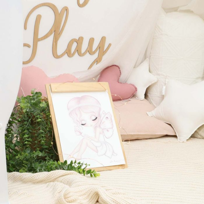 Reading Nook with fairy print, plant, blankets, medium white star cushion, dusty pink dolls heart cushion and white dolls star cushion