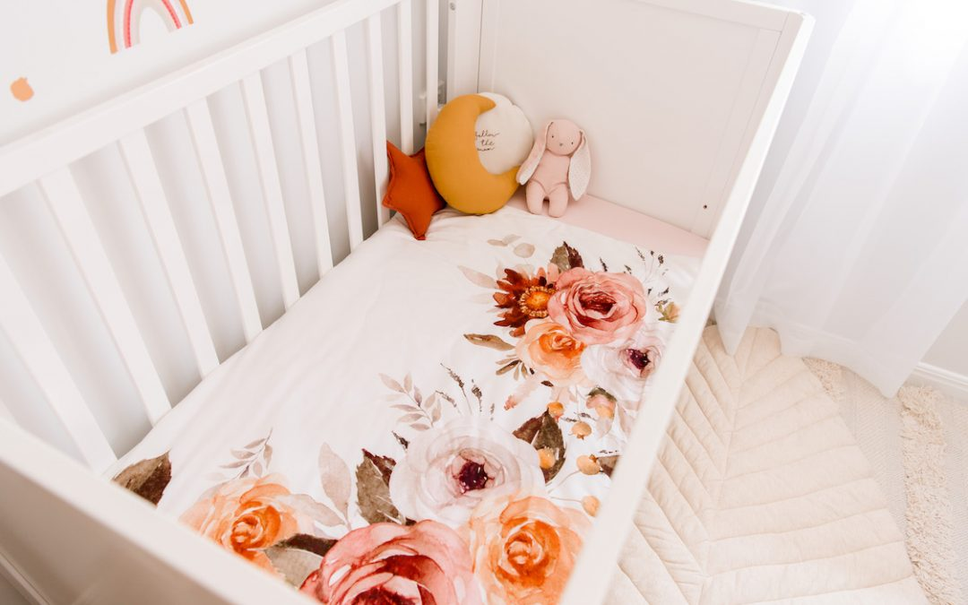 Kids Interior Trend of 2020 - Cot with Floral Bedding, Toy Bunny and Round Embroidered Cushion, Medium Mustard Moon Cushion and Small Rust Star Cushion