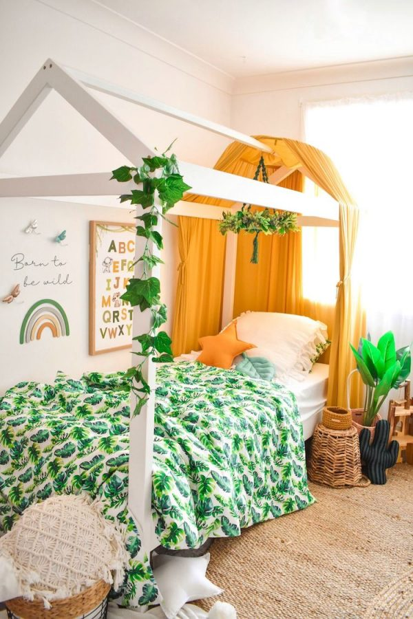 Safari Inspired Bedroom - House Bed with Jungle Leaves, Mustard Canopy, Alphabet Print and Rainbow on the wall. White and Mustard Star Cushions and Sage Green Leaf Cushion
