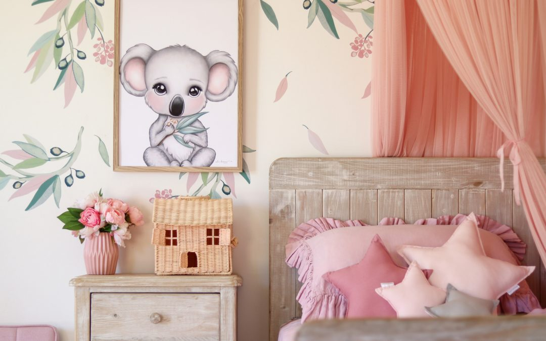 Create a Statement in a Kids Space - Girls Australiana Bedroom - Pinks and Greys. Canopy over Bed, Gum Leaf Wall Decals, Koala Artwork on Wall, Rattan Dollhouse and Star Cushions on Bed
