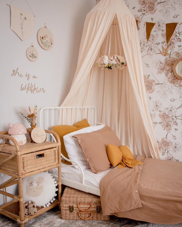 Girls Vintage Bedroom - IKEA Toddler Bed, Beige Canopy, Rattan Side Table and cases, Floral Wallpaper, Floral Mobile and Mustard Bow Cushion