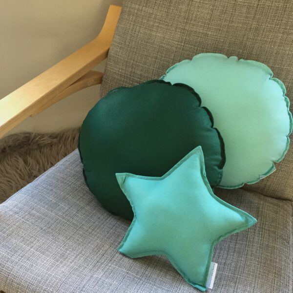 Aqua & Forest Green Round Cushions sitting on rocking chair with Small Sage Star